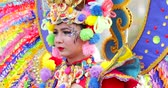 şenlik : JAKARTA, Indonesia - May 31, 2018: Beautiful participant of Asian Games 2018 Parade smiling at the camera while wearing colorful accessories. Shot in 4k resolution