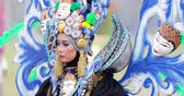 ünnepségek : JAKARTA, Indonesia - May 31, 2018: Beautiful participant of Asian Games 2018 Parade smiling at the camera while wearing colorful accessories. Shot in 4k resolution