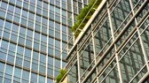 apartamentos : JAKARTA, Indonesia - July 04, 2018: Low angle view of modern building with glass windows in business district of Jakarta