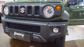 бампер : Tangerang, Indonesia - August 08, 2018: Closeup of front bumper of Suzuki Jimny car at Gaikindo Indonesia International Auto Show. Shot in 4k resolution Стоковые видеозаписи