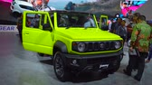visitantes : Tangerang, Indonesia - August 08, 2018: New Suzuki Jimny car showed in a booth at Gaikindo Indonesia International Auto Show. Shot in 4k resolution