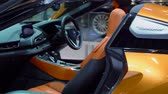 kifinomult : Tangerang, Indonesia - August 08, 2018: Interior of new BMW i8 Roadster car in Gaikindo International Auto Show. Shot in 4k resolution Stock mozgókép