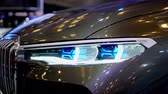 kifinomult : Tangerang, Indonesia - August 08, 2018: Headlight of BMW Concept X7 iPerformance car with shiny exterior showed in Gaikindo Indonesia International Auto Show. Shot in 4k resolution Stock mozgókép