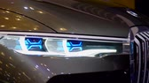 tanıtım : Tangerang, Indonesia - August 08, 2018: Headlamp of BMW Concept X7 iPerformance car with shiny front exterior displayed in Gaikindo Indonesia International Auto Show. Shot in 4k resolution Stok Video