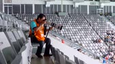 vzít : JAKARTA, Indonesia - August 24, 2018: Male photographer taking pictures with a large lens on the stadium during Asian Games match