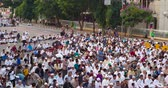 road top view : JAKARTA, Indonesia - August 24, 2018: Time lapse footage of crowded muslim people ready to pray together on the street during Eid Al Adha day. Shot in 4k resolution