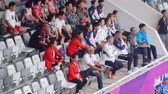 entusiasmo : JAKARTA, Indonesia - August 30, 2018: Member of South Korea official team supporting their team on badminton match in Asian Games 2018 at stadium. Shot in 4k resolution