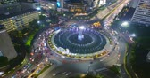 szív : JAKARTA, Indonesia - September 13, 2018: Beautiful aerial landscape of Hotel Indonesia Roundabout at night with fountain and busy traffic. Shot in 4k resolution Stock mozgókép