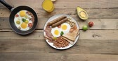stopmotion : Stop motion of breakfast foods on the plate over wooden table. Shot in 4k resolution