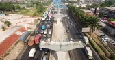 незаконченный : West Java, Indonesia - October 03, 2018: Aerial view of traffic jam on the construction of Jakarta-Cikampek elevated toll road site. Shot in 4k resolution Стоковые видеозаписи