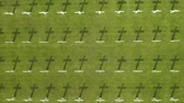 veterán : Aerial view of Ereveld Menteng Pulo or Dutch Cemetery with green grass and rows of white crosses in Jakarta, Indonesia. Shot in 4k resolution