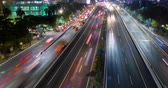 Центральный район : JAKARTA, Indonesia - October 19, 2018: Aerial hyperlapse of toll road with night traffic and light trails of moving vehicles in Jakarta city, Indonesia. Shot in 4k resolution Стоковые видеозаписи