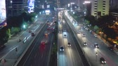 iç : JAKARTA, Indonesia - October 23, 2018: Aerial footage of Jakarta tollway at night with moving vehicles and light trails. Shot in 4k resolution Stok Video