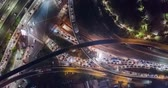 джем : JAKARTA, Indonesia - November 08, 2018: Beautiful aerial hyperlapse of Tomang highway interchange with traffic jam at night. Shot in 4k resolution Стоковые видеозаписи