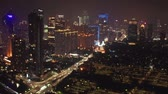cenaze : JAKARTA, Indonesia - November 06, 2018: Panoramic aerial landscape of Jakarta city at nighttime with night lights and skyscrapers. Shot in 4k resolution