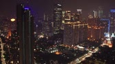 cenaze : JAKARTA, Indonesia - November 06, 2018: Beautiful aerial footage of skyscrapers on nighttime in Jakarta downtown with night lights view. Shot in 4k resolution