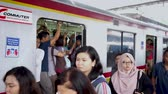 JAKARTA, Indonesia - November 13, 2018: Commuter train full of passengers standing near the door at rush hour in Jakarta, Indonesia