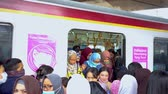 csak felnőtteknek : JAKARTA, Indonesia - November 13, 2018: Crowded female passengers get off from the commuter train special for women in the train station