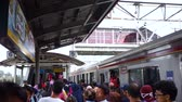 ingázó : JAKARTA, Indonesia - November 13, 2018: Crowded passengers walking on the station platform at rush hours in Jakarta, Indonesia