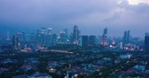 JAKARTA, Indonesia - December 14, 2018: Beautiful hyperlapse of Jakarta cityscape with residential houses and skyscrapers at dusk to night. Shot in 4k resolution