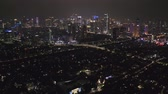 JAKARTA, Indonesia - December 14, 2018: Aerial panorama of Jakarta downtown with skyscrapers and night lights. Shot in 4k resolution Vidéos Libres De Droits