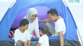 kids tent : Happy family playing together while sitting inside a camping tent. Shot in 4k resolution Stock Footage