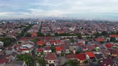 вид сверху : JAKARTA, Indonesia - January 02, 2019: Aerial landscape of Jakarta cityscape with dense residential houses. Shot in 4k resolution