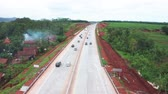 トランス : Semarang, Central Java  Indonesia - January 11, 2019: Aerial view of traffic on Trans-Java Toll Road at Semarang to Solo, Central Java, Indonesia. Shot in 4k resolution 動画素材