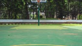 the game : Empty outdoor basketball court with green floor and basket hoop. Shot in 4k resolution