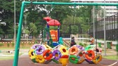 oyun alanı : JAKARTA, Indonesia - January 22, 2019: Colorful playground with swing on the yard at the park. Shot in 4k resolution