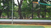 район : Empty basketball court with basketball hoop and green trees background at the park. Shot in 4k resolution