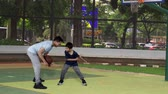 board game : Little boy and his father playing basketball together on the outdoors basketball court. Shot in 4k resolution Stock Footage