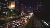 congestionamento : JAKARTA, Indonesia - February 11, 2019: Night traffic jam with crowded vehicles on Sudirman street in Jakarta city, Indonesia. Shot in 4k resolution Vídeos