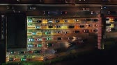 porta de entrada : Top down view of night traffic on toll road gateway in Jakarta downtown, Indonesia. Shot in 4k resolution