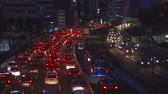 congestionamento : JAKARTA, Indonesia - February 11, 2019: Night traffic jam on Sudirman highway in Jakarta city, Indonesia. Shot in 4k resolution
