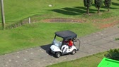 golfing : BANDUNG, Indonesia - February 13, 2019: Aerial view of man driving a golf cart at Heritage Dago Golf Course. Shot in 4k resolution