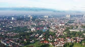западный : Beautiful aerial landscape of Bandung city with residential houses on misty morning, West Java, Indonesia. Shot in 4k resolution Стоковые видеозаписи