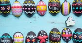 egg painted : Stop motion of handmade chocolate easter eggs and easter rabbit on wooden table. Shot in 4k resolution