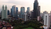 bird eye view : JAKARTA, Indonesia - February 28, 2019: Aerial view of modern office buildings and Astra office tower in Jakarta downtown. Shot in 4k resolution Stock Footage
