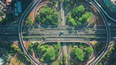 autostrada : Top down view of Semanggi intersection from a drone flying down on the morning in Jakarta city, Indonesia. Shot in 4k resolution