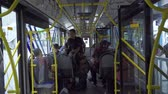 ingázó : JAKARTA, Indonesia - March 21, 2019: Modern city bus interior with passengers. Shot in 4k resolution