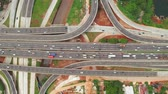 ring road : Top down view of Depok Antasari toll road intersection from a drone flying from left to right. Shot in 4k resolution Stock Footage