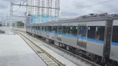 地下鉄 : Jakarta Mass Rapid Transit (MRT) moving on the track and leaving the station 動画素材