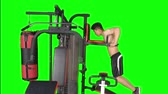 бицепс : Young Asian man exercising on fitness machine with green screen background. Shot in 4k resolution Стоковые видеозаписи
