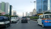 způsob dopravy : JAKARTA, Indonesia - May 14, 2019: Cars moving slowly on tollway at rush hour with skyscrapers view