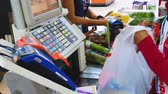 gıda maddeleri : JAKARTA, Indonesia - May 21, 2019: Closeup of cashier hand counting the buyer groceries on the cashier machine in supermarket Stok Video