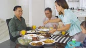 três pessoas : Happy family having lunch together in dining room at home. Shot in 4k resolution