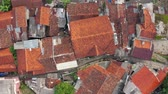 corredor : BANDUNG, Indonesia - July 03, 2019: Top down view of rooftop of crowded residential houses with small alley in Bandung city, West Java, Indonesia. Shot in 4k resolution