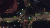asfalt : JAKARTA, Indonesia - July 15, 2019: Top down view of a road intersection at night in business center. Shot in 4k resolution from a drone flying upwards
