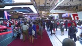 kifinomult : JAKARTA, Indonesia - July 23, 2019: Crowded visitors in GAIKINDO Indonesia International Auto Show (GIIAS) 2019 at Indonesia Convention Exhibition (ICE) Stock mozgókép